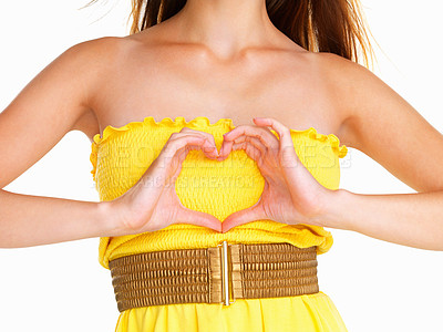 Buy stock photo Woman making heart sign over her heart
