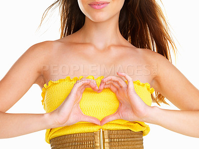 Buy stock photo Smiling woman making heart sign over heart
