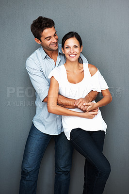 Buy stock photo Playful couple goofing around near wall