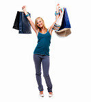 Full portrait of a happy young lady holding shopping bags