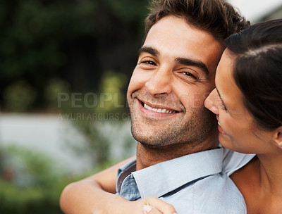 Buy stock photo Attractive couple embracing outdoors