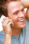 Happy young man talking on phone