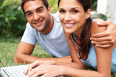 Buy stock photo Handsome man and woman outdoors with laptop
