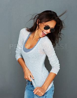 Buy stock photo Sexy woman wearing sunglasses against gray background