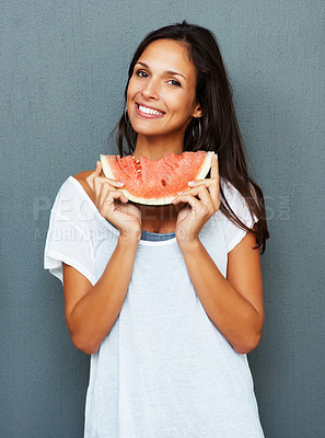 Buy stock photo Woman against blue background holding watermelon under chin