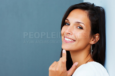 Buy stock photo Pretty woman smiling and gesturing against blue background
