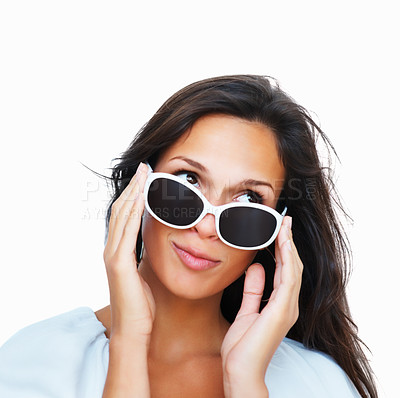 Buy stock photo Head shot of flirtatious woman holding sunglasses against white background