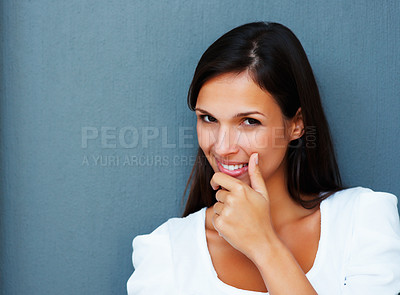 Buy stock photo Woman with hand over chin against blue background