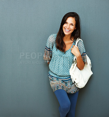 Buy stock photo Inviting woman with purse on shoulder against blue background