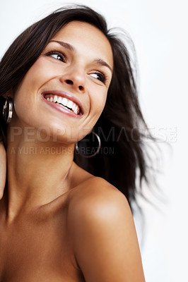 Buy stock photo Closeup portrait of a beautiful young woman looking away against white background