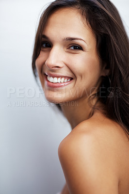 Buy stock photo Closeup portrait of a sexy young woman smiling against white background