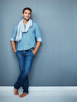 Buy stock photo Portrait of a handsome young man standing with his hands in his pockets