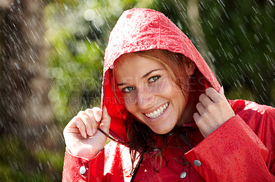 Buy stock photo Portrait of beautiful young girl wearing a raincoat enjoying the rain