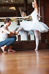 Male ballet trainer training a female ballet dancer