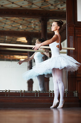 Buy stock photo Full length of a young ballerina dancing gracefully next to mirror