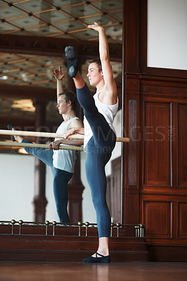 Buy stock photo Full length of a young male ballet dancer practicing against mirror