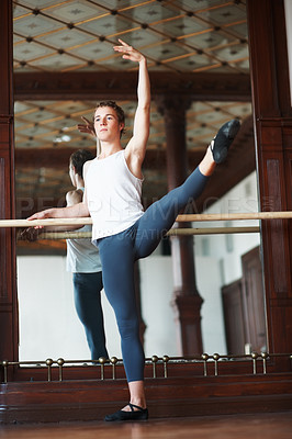 Buy stock photo Full length of a young male ballet practicing in front of mirror