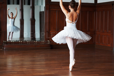 Ballerina practicing in front of a mirror