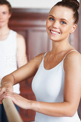 Buy stock photo Portrait of a pretty female dancer with trainer in background