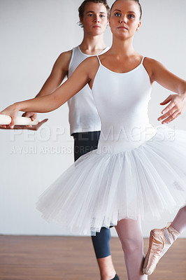 Buy stock photo Portrait of a young ballerina dancing with trainer in background