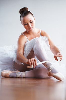 Buy stock photo Portrait of a young ballerina puts on Pointe before appearance