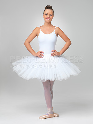 Buy stock photo Full length of a cute ballerina wearing white tutu posing against white background