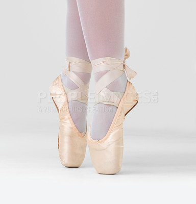 Buy stock photo Low angle shot of a dancer in ballet shoes dancing in Pointe against white background