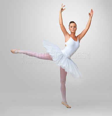 Buy stock photo Full length of a beautiful young ballerina dancing against white background