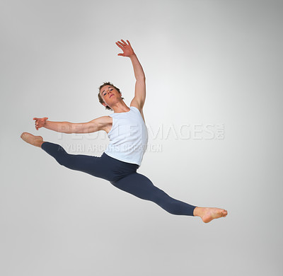 Buy stock photo Full length of a young ballet dancer practicing high jump against white background - copyspace