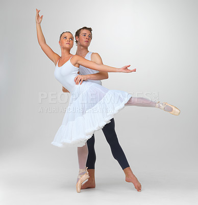 Buy stock photo Full length of two graceful ballet dancers performing against white background