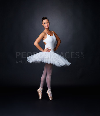 Buy stock photo Full length of a pretty ballerina posing against black background - copyspace