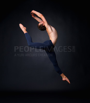 Buy stock photo Full length of a young graceful ballet dancer leaping against black background