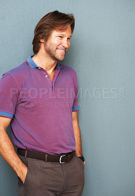 Buy stock photo Portrait of a smart mature man smiling over a happy thought , hands in pockets
