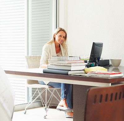 Buy stock photo Portrait of a mature female executive at work desk using computer