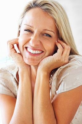 Buy stock photo Mature happy woman giving you a cute smile against white