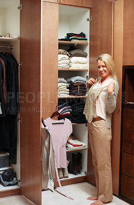 Buy stock photo Happy mature woman standing at wardrobe and chooses what can to dress