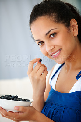 Buy stock photo Portrait of happy young women eating blackberries at home - Indoors