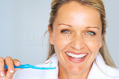 Buy stock photo Closeup portrait of a happy beautiful woman brushing her teeth