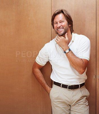 Buy stock photo Portrait of a friendly mature man smiling with hand on chin