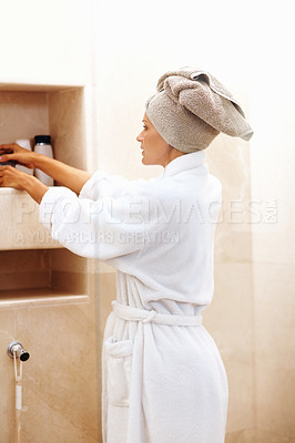 Buy stock photo Portrait of a mature woman arranging toiletries after a bath