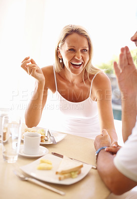 Buy stock photo Portrait of a cheerful mature couple having fun while having breakfast