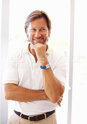 Buy stock photo Portrait of a mature man smiling with hand on chin against bright background
