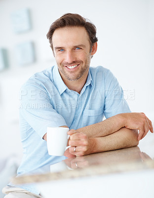 Buy stock photo Portrait of a happy young man with cup of coffee - Indoor