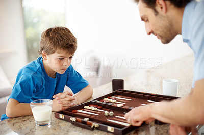 Buy stock photo Portrait of a father and son playing backgammon game in kitchen  - Indoor
