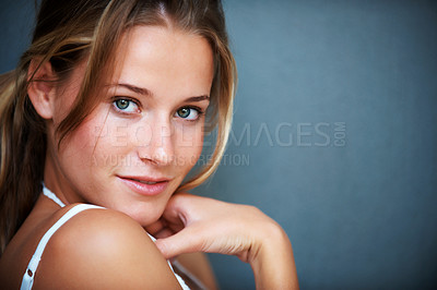 Buy stock photo Closeup portrait of sensual young girl posing confidently on grey background