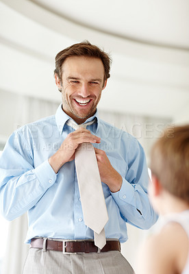 Buy stock photo Portrait of a happy young father wearing tie with his son standing in front