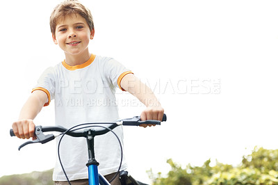 Buy stock photo Portrait of a healthy small kid standing with a bicycle outdoor - Copyspace