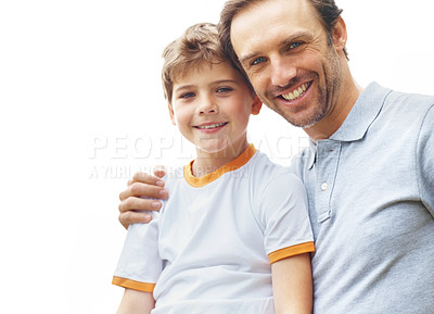 Buy stock photo Portrait of a small boy and his father looking happy outside agiainst bright background