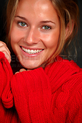 Buy stock photo Closeup portrait of a happy young girl wearing a red woolen sweater