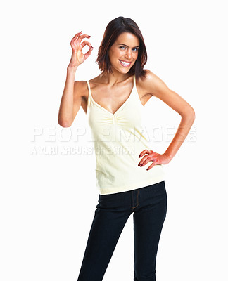 Buy stock photo A happy mixed race young girl giving the OK sign against white background